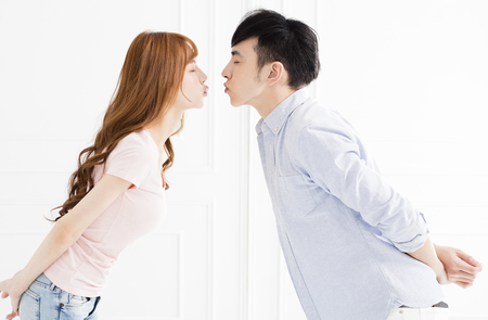 closeup young asian couple kissing
