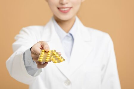 smiling female doctor giving pills  Stock Photo