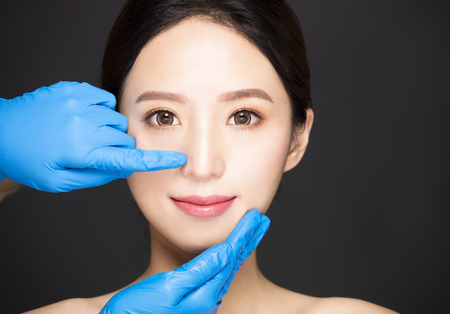 closeup  young woman face with medical beauty concept 스톡 콘텐츠