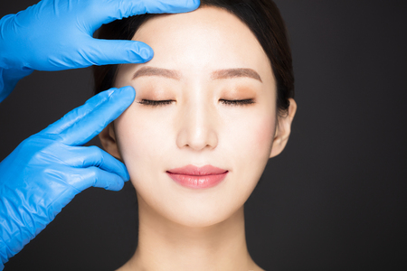closeup  young woman face with medical beauty concept Stockfoto