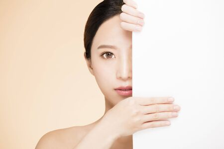 half  beauty face with blank board concept Stock Photo