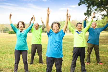 happy Senior Group Friends Exercise and   having fun Stock Photo