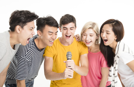 Group of happy friends singing song together  版權商用圖片