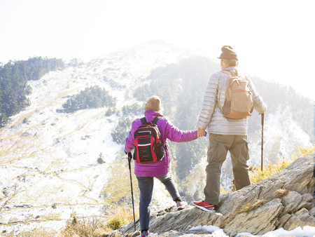 happy senior couple hiking on the mountain Stock Photo