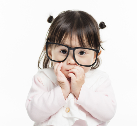 Portrait of little girl with glasses