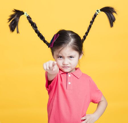 closeup angry little girl face Foto de archivo