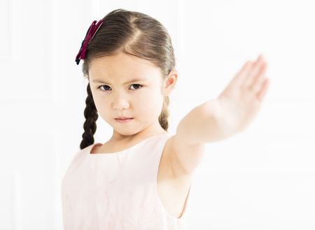 angry little girl showing stop sign  Stock Photo