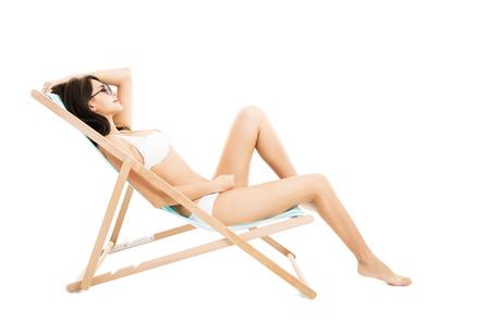 beautiful bikini young woman in lounge chair