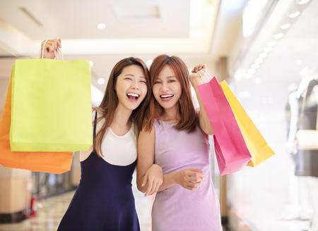 Beautiful girls shopping in the mall