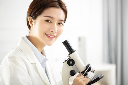 female medical or scientific researcher working in office