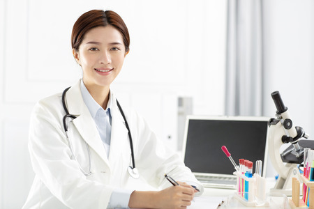 female medical or scientific researcher working in office 스톡 콘텐츠 - 102256456