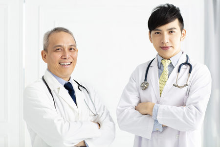 Portrait of two smiling doctors  standing