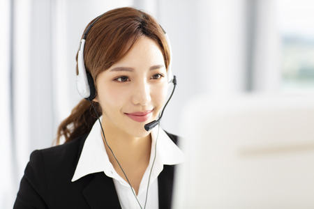 beautiful young business woman operator in headset