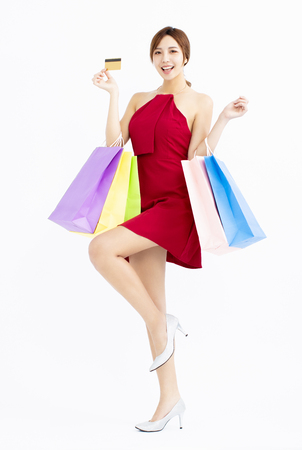 Happy young Woman with shopping bags and credit card Stock fotó