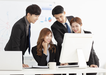 young business team discuss in office