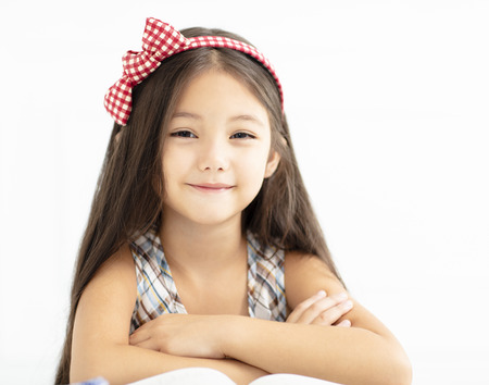 Closeup of smiling little girl with long hair