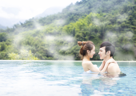 Young asian couple relaxing in hot springs