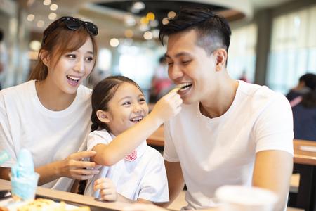 Happy family  enjoying dinner in restaurant.