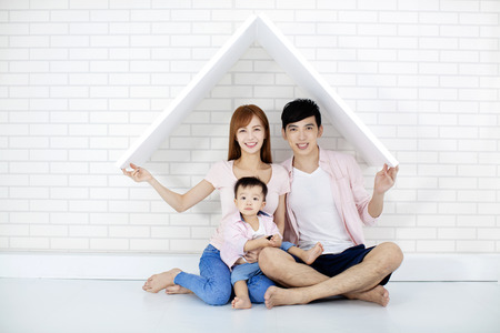 happy family  in new house with roof