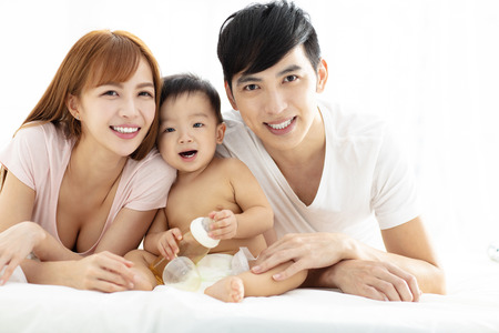 happy young father and mother  with baby