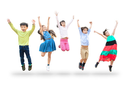 happy kids jumping in air over white background 스톡 콘텐츠