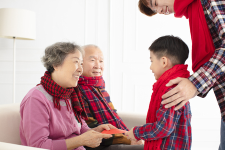 Happy  Asian family celebrate Chinese new year at home Standard-Bild