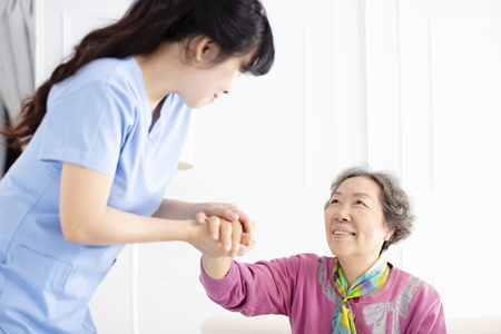 Health visitor and  senior woman during home visit
