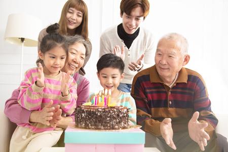 happy asian Family celebrating childs birthday