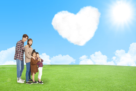 Happy family with cloud of love in the sky