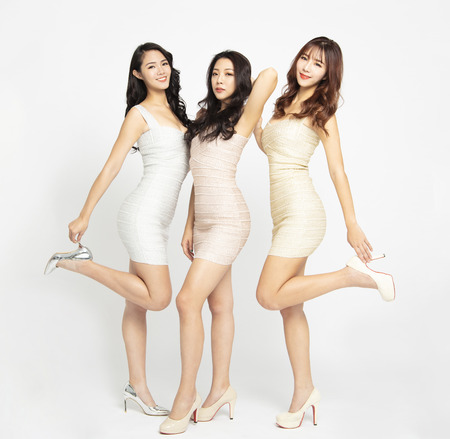 full length of beautiful asian young woman group 스톡 콘텐츠