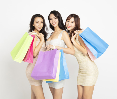 three beautiful girls  with shopping bags