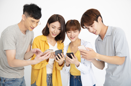 happy young student people watching the  smartphones