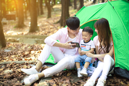 happy Family Enjoy Camping Holiday In Countryside