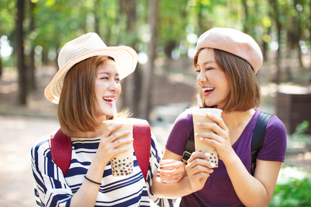 happy girls drinking bubble tea and enjoy summer vacation  Фото со стока