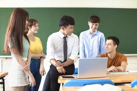 teacher with group of college students in classroom