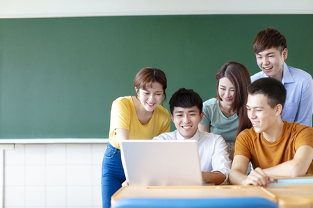 Class Of University Students Using Laptops In classroom