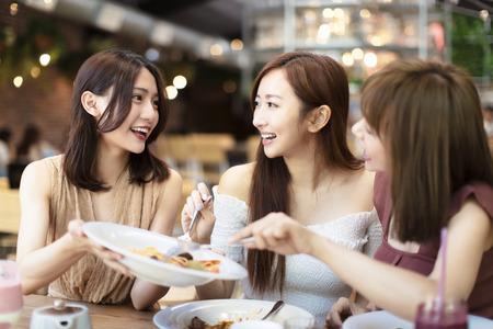 Group of Happy friends having dinner in the restaurant