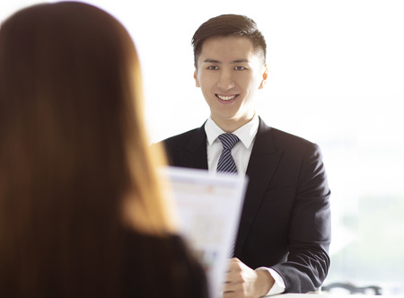female Manager Interviewing A Young man In Office