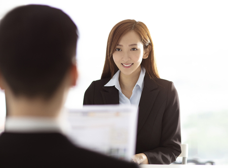 Male Manager Interviewing A Young woman In Office