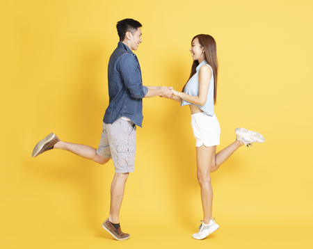 happy young couple in summer  casual clothes dancing