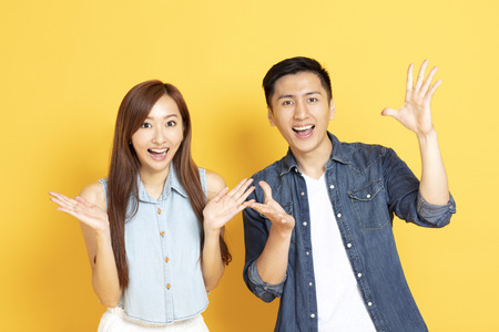 surprised Asian young couple in summer casual clothes Stock Photo