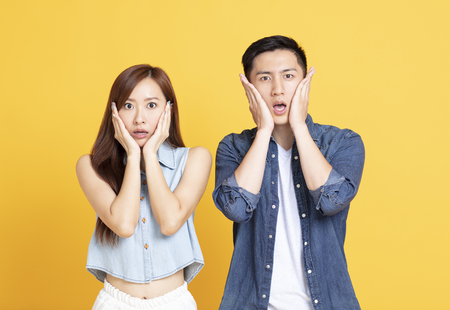 shocked man and woman screaming and touching face Stok Fotoğraf - 123846340