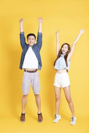 happy young couple in summer casual clothes celebrating