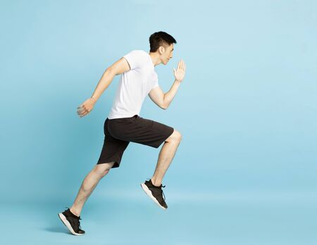 Full length portrait of young fitness man running
