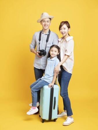 happy family with suitcase going on summer vacation