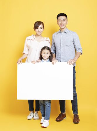 happy  family with blank advertising banner