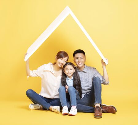 happy asian family in new house with roof concept Stock Photo