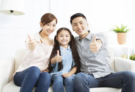 Happy parents and child having fun together