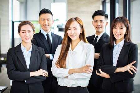 confident asian business team stands in office Stockfoto