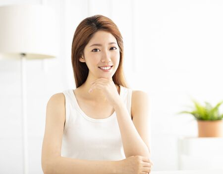 closeup smiling young asian woman in living room Stock Photo